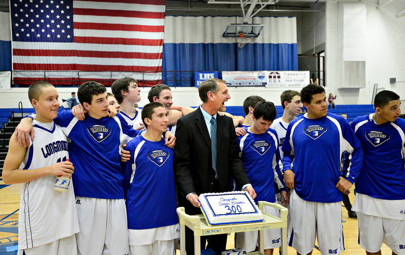 "Longmont head coach Jeff Kloster celebrates his 300th career victory with his team after the game at Longmont High School on Tuesday, Jan. 22, 2013. Longmont beat Mountain View 75, Mountain View 38. For more photos visit  <a href=""http://www.BoCopreps.com"">http://www.BoCopreps.com</a><br /> (Greg Lindstrom/Times-Call)"