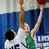 "Niwot's Kyle Kolakowski shoots over Longmont's Marcus Johnson during the game at Longmont High School on Friday, Jan. 11, 2013. Longmont beat Niwot 50-46. For more photos visit  <a href=""http://www.BoCoPreps.com"">http://www.BoCoPreps.com</a>.<br /> (Greg Lindstrom/Times-Call)"