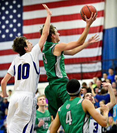 "Niwot's Jordan Keeler (3) goes up for a shot over Longmont's Justinian Jessup (10) during the game at Longmont High School on Friday, Jan. 11, 2013. Longmont beat Niwot 50-46. For more photos visit  <a href=""http://www.BoCoPreps.com"">http://www.BoCoPreps.com</a>.<br /> (Greg Lindstrom/Times-Call)"