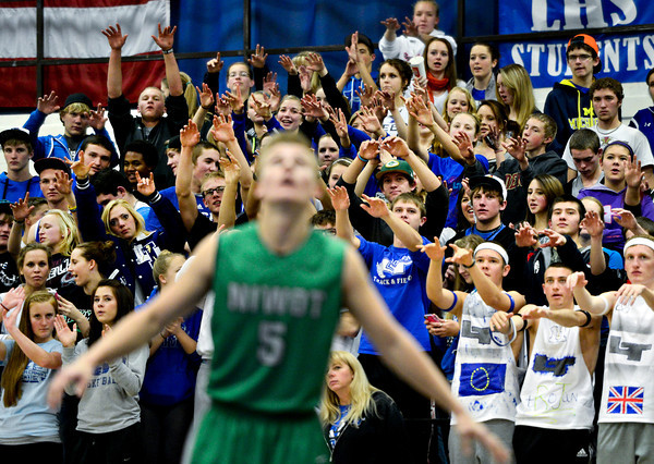 """Longmont students cheer during the game at Longmont High School on Friday, Jan. 11, 2013. Longmont beat Niwot 50-46. For more photos visit  <a href=""""http://www.BoCoPreps.com"""">http://www.BoCoPreps.com</a>.<br /> (Greg Lindstrom/Times-Call)"""