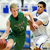 """Niwot's Madison Bounds (15) drives past Longmont's Marcus Johnson during the game at Longmont High School on Friday, Jan. 11, 2013. Longmont beat Niwot 50-46. For more photos visit  <a href=""""http://www.BoCoPreps.com"""">http://www.BoCoPreps.com</a>.<br /> (Greg Lindstrom/Times-Call)"""