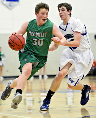 "Niwot's Jared Hart (30) drives past Longmont's Justinian Jessup during the game at Longmont High School on Friday, Jan. 11, 2013. Longmont beat Niwot 50-46. For more photos visit  <a href=""http://www.BoCoPreps.com"">http://www.BoCoPreps.com</a>.<br /> (Greg Lindstrom/Times-Call)"