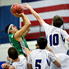 """Niwot's Forrest Lee (4) tries to shoot over Longmont's Justinian Jessup during the game at Longmont High School on Friday, Jan. 11, 2013. Longmont beat Niwot 50-46. For more photos visit  <a href=""""http://www.BoCoPreps.com"""">http://www.BoCoPreps.com</a>.<br /> (Greg Lindstrom/Times-Call)"""