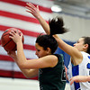 "Niwot's Anessa Calvert (22) pulls down a rebound over Longmont's Dailyn Johnson (34) during the game at Longmont High School on Tuesday, Feb. 5, 2013. Longmont beat Niwot 71-27. For more photos visit  <a href=""http://www.BoCoPreps.com"">http://www.BoCoPreps.com</a>.<br /> (Greg Lindstrom/Times-Call)"