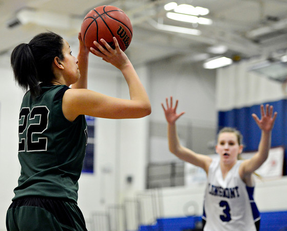 """Niwot's Anessa Calvert (22) shoots over Longmont's Gabriella Fallon (3) during the game at Longmont High School on Tuesday, Feb. 5, 2013. Longmont beat Niwot 71-27. For more photos visit  <a href=""""http://www.BoCoPreps.com"""">http://www.BoCoPreps.com</a>.<br /> (Greg Lindstrom/Times-Call)"""