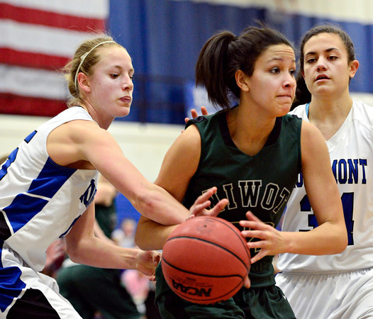 """Longmont's Sydney Wetterstrom, left, and Dailyn Johnson (34) defend Niwot's Anessa Calvert (22) during the game at Longmont High School on Tuesday, Feb. 5, 2013. Longmont beat Niwot 71-27. For more photos visit  <a href=""""http://www.BoCoPreps.com"""">http://www.BoCoPreps.com</a>.<br /> (Greg Lindstrom/Times-Call)"""
