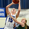 "Longmont's Sydney Wetterstrom (15) shoots over Niwot's Jacqui Sigg (23) during the game at Longmont High School on Tuesday, Feb. 5, 2013. Longmont beat Niwot 71-27. For more photos visit  <a href=""http://www.BoCoPreps.com"">http://www.BoCoPreps.com</a>.<br /> (Greg Lindstrom/Times-Call)"