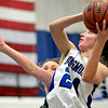 "Longmont's Anna Schell (24) shoots over Niwot's Jacqui Sigg during the game at Longmont High School on Tuesday, Feb. 5, 2013. Longmont beat Niwot 71-27. For more photos visit  <a href=""http://www.BoCoPreps.com"">http://www.BoCoPreps.com</a>.<br /> (Greg Lindstrom/Times-Call)"