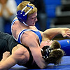 "Silver Creek's Daniel McLean struggles to get out of a hold by Longmont's Colten Montgomery during the wrestling meet at Longmont High School on Thursday, Dec. 13, 2012. For a more photos visit  <a href=""http://www.BoCoPreps.com"">http://www.BoCoPreps.com</a>.<br /> (Greg Lindstrom/Times-Call)"