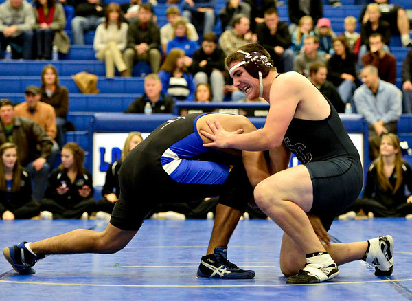 "Silver Creek's Kenny Jones, right, tries to break away from Longmont's Jaime Ramos Vega during the wrestling meet at Longmont High School on Thursday, Dec. 13, 2012. For a more photos visit  <a href=""http://www.BoCoPreps.com"">http://www.BoCoPreps.com</a>.<br /> (Greg Lindstrom/Times-Call)"