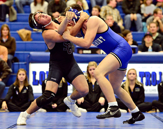"Silver Creek's Dakota Silva, left, competes against Longmont's Dutch Warner during the wrestling meet at Longmont High School on Thursday, Dec. 13, 2012. For a more photos visit  <a href=""http://www.BoCoPreps.com"">http://www.BoCoPreps.com</a>.<br /> (Greg Lindstrom/Times-Call)"