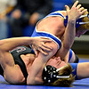 """Silver Creek's Daniel McLean struggles to get out of a hold by Longmont's Colten Montgomery during the wrestling meet at Longmont High School on Thursday, Dec. 13, 2012. For a more photos visit  <a href=""""http://www.BoCoPreps.com"""">http://www.BoCoPreps.com</a>.<br /> (Greg Lindstrom/Times-Call)"""