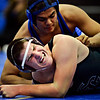 """Silver Creek's Kenny Jones grimaces as he competes against Longmont's Jaime Ramos Vega during the wrestling meet at Longmont High School on Thursday, Dec. 13, 2012. For a more photos visit  <a href=""""http://www.BoCoPreps.com"""">http://www.BoCoPreps.com</a>.<br /> (Greg Lindstrom/Times-Call)"""