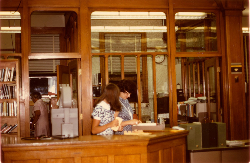 A color photo of the interior of the Carnegie Library, again from the late 1960s or early 1970s.<br /> (Courtesy Longmont Museum)