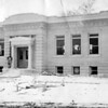 Builder Frank Wiggins is seen standing in front of the Carnegie Library as it was under construction.<br /> (Courtesy Longmont Museum)
