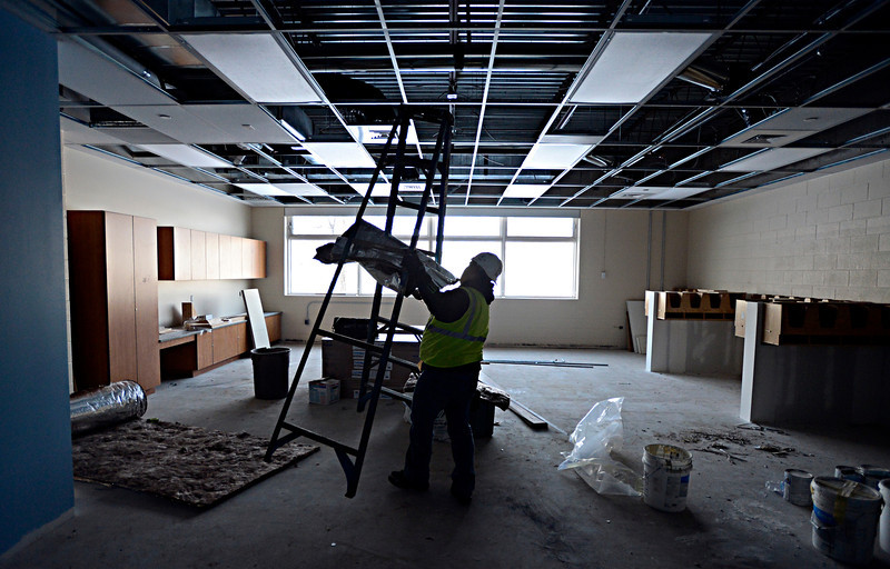 Michael Gonzales, with Mechanical Insulation Systems, Inc., moves a ladder while working recently in a future classroom at Thunder Valley K-8 School in Frederick, which is scheduled to open in August.<br /> (Greg Lindstrom/Times-Call)