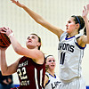 "Lyons' Olivia Raspotnik (11) tries to block a shot by Frontier Academy's Jordan Wagner (22) during the game at Lyons High School on Thursday, Jan. 17, 2013. Frontier Academy beat Lyons 67-40. For more photos visit  <a href=""http://www.BoCoPreps.com"">http://www.BoCoPreps.com</a>. <br /> (Greg Lindstrom/Times-Call)"