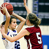 """Lyons' Lauren Simms (22) is defended by Frontier Academy's Kylie Lyman (5) during the game at Lyons High School on Thursday, Jan. 17, 2013. Frontier Academy beat Lyons 67-40. For more photos visit  <a href=""""http://www.BoCoPreps.com"""">http://www.BoCoPreps.com</a>. <br /> (Greg Lindstrom/Times-Call)"""