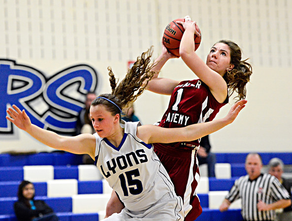 "Frontier Academy's Krista Thaxton (1) tries to shoot over Lyons' Carla Walko (15) during the game at Lyons High School on Thursday, Jan. 17, 2013. Frontier Academy beat Lyons 67-40. For more photos visit  <a href=""http://www.BoCoPreps.com"">http://www.BoCoPreps.com</a>. <br /> (Greg Lindstrom/Times-Call)"