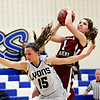 """Frontier Academy's Krista Thaxton (1) tries to shoot over Lyons' Carla Walko (15) during the game at Lyons High School on Thursday, Jan. 17, 2013. Frontier Academy beat Lyons 67-40. For more photos visit  <a href=""""http://www.BoCoPreps.com"""">http://www.BoCoPreps.com</a>. <br /> (Greg Lindstrom/Times-Call)"""