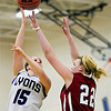 """Lyons' Carla Walko (15) shoots over Frontier Academy's Jordan Wagner (22) during the game at Lyons High School on Thursday, Jan. 17, 2013. Frontier Academy beat Lyons 67-40. For more photos visit  <a href=""""http://www.BoCoPreps.com"""">http://www.BoCoPreps.com</a>. <br /> (Greg Lindstrom/Times-Call)"""