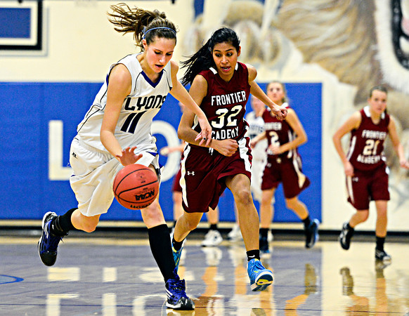 "Lyons' Olivia Raspotnik (11) runs down a loose ball as Frontier Academy's Maryln Granillo (32) defends during the game at Lyons High School on Thursday, Jan. 17, 2013. Frontier Academy beat Lyons 67-40. For more photos visit  <a href=""http://www.BoCoPreps.com"">http://www.BoCoPreps.com</a>. <br /> (Greg Lindstrom/Times-Call)"