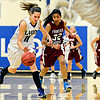"""Lyons' Olivia Raspotnik (11) runs down a loose ball as Frontier Academy's Maryln Granillo (32) defends during the game at Lyons High School on Thursday, Jan. 17, 2013. Frontier Academy beat Lyons 67-40. For more photos visit  <a href=""""http://www.BoCoPreps.com"""">http://www.BoCoPreps.com</a>. <br /> (Greg Lindstrom/Times-Call)"""