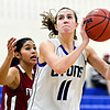 """Lyons' Olivia Raspotnik (11) goes up for a shot over Frontier Academy's Marlyn Granillo, left, during the game at Lyons High School on Thursday, Jan. 17, 2013. Frontier Academy beat Lyons 67-40. For more photos visit  <a href=""""http://www.BoCoPreps.com"""">http://www.BoCoPreps.com</a>. <br /> (Greg Lindstrom/Times-Call)"""