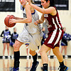 "Lyons' Olivia Raspotnik, left, tries to drive past Frontier Academy's Maddie Zenk during the game at Lyons High School on Thursday, Jan. 17, 2013. Frontier Academy beat Lyons 67-40. For more photos visit  <a href=""http://www.BoCoPreps.com"">http://www.BoCoPreps.com</a>. <br /> (Greg Lindstrom/Times-Call)"