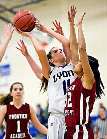 "Lyons' Olivia Raspotnik (11) goes up for a shot over Frontier Academy's Marlyn Granillo (32) during the game at Lyons High School on Thursday, Jan. 17, 2013. Frontier Academy beat Lyons 67-40. For more photos visit  <a href=""http://www.BoCoPreps.com"">http://www.BoCoPreps.com</a>. <br /> (Greg Lindstrom/Times-Call)"