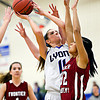 """Lyons' Olivia Raspotnik (11) goes up for a shot over Frontier Academy's Marlyn Granillo (32) during the game at Lyons High School on Thursday, Jan. 17, 2013. Frontier Academy beat Lyons 67-40. For more photos visit  <a href=""""http://www.BoCoPreps.com"""">http://www.BoCoPreps.com</a>. <br /> (Greg Lindstrom/Times-Call)"""