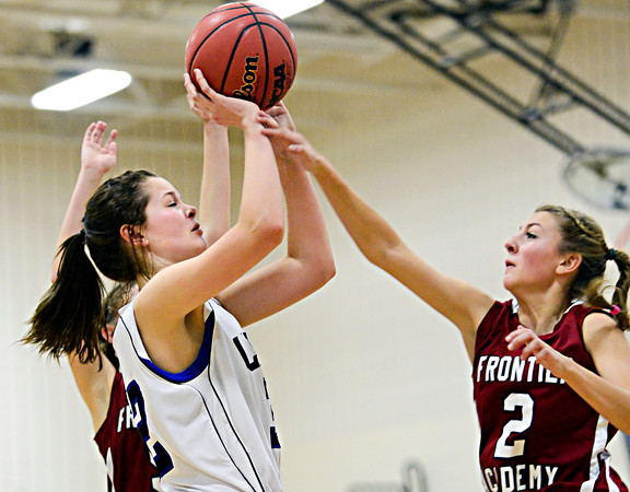 "Lyons' Maizie Grace is fouled by Frontier Academy's Alexa Rose (2) during the game at Lyons High School on Thursday, Jan. 17, 2013. Frontier Academy beat Lyons 67-40. For more photos visit  <a href=""http://www.BoCoPreps.com"">http://www.BoCoPreps.com</a>. <br /> (Greg Lindstrom/Times-Call)"