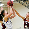 """Lyons' Maizie Grace is fouled by Frontier Academy's Alexa Rose (2) during the game at Lyons High School on Thursday, Jan. 17, 2013. Frontier Academy beat Lyons 67-40. For more photos visit  <a href=""""http://www.BoCoPreps.com"""">http://www.BoCoPreps.com</a>. <br /> (Greg Lindstrom/Times-Call)"""