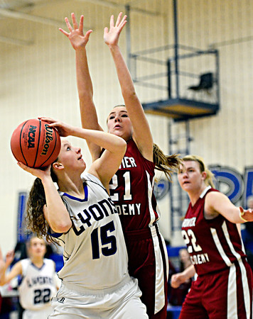 """Lyons' Carla Walko (15) looks to shoot over Frontier Academy's Ella Rasmuson (21) during the game at Lyons High School on Thursday, Jan. 17, 2013. Frontier Academy beat Lyons 67-40. For more photos visit  <a href=""""http://www.BoCoPreps.com"""">http://www.BoCoPreps.com</a>. <br /> (Greg Lindstrom/Times-Call)"""