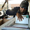 """Jose Chavez reaches for mail as he delivers along his route in Longmont on Thursday, Dec. 13, 2012. Despite being diagnosed with multiple sclerosis in 2001, Chavez has been delivering mail along the same route for 12 years. For more photos and video visit  <a href=""""http://www.TimesCall.com"""">http://www.TimesCall.com</a>.<br /> (Greg Lindstrom/Times-Call)"""