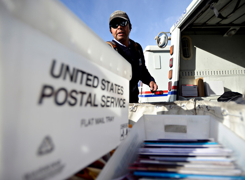 """Jose Chavez loads his truck before leaving the Post Office at 201 Coffman St. in Longmont to deliver mail along his route on Tuesday, Dec. 18, 2012. Despite being diagnosed with multiple sclerosis in 2001, Chavez has been delivering mail along the same route for 12 years. For more photos and video visit  <a href=""""http://www.TimesCall.com"""">http://www.TimesCall.com</a>.<br /> (Greg Lindstrom/Times-Call)"""
