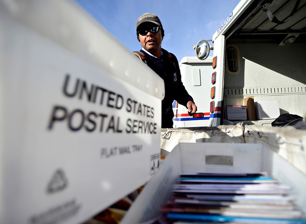 "Jose Chavez loads his truck before leaving the Post Office at 201 Coffman St. in Longmont to deliver mail along his route on Tuesday, Dec. 18, 2012. Despite being diagnosed with multiple sclerosis in 2001, Chavez has been delivering mail along the same route for 12 years. For more photos and video visit  <a href=""http://www.TimesCall.com"">http://www.TimesCall.com</a>.<br /> (Greg Lindstrom/Times-Call)"