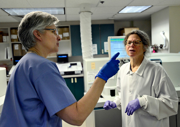 """Phlebotomist Deb Romero asks lab technician Carol Statland about a blood sample at the outpatient lab at Longmont United Hospital on Friday, Dec. 21, 2012. For more photos visit  <a href=""""http://www.TimesCall.com"""">http://www.TimesCall.com</a>.<br /> (Greg Lindstrom/Times-Call)"""