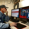 Plant Operator Keith Kendall, monitors systems via monitors at a desk, Monday, Dec. 3, 2012, at the City of Longmont Wastewater Treatment plant. Kendall has worked at the plant for 32 years.<br /> (Matthew Jonas/Times-Call)