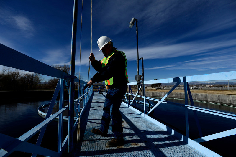 "Plant Operator Keith Kendall checks the number of ""bugs"", microorganisms that breakdown solid waste particles, in a storage tank, Monday, Dec. 3, 2012, at the City of Longmont Wastewater Treatment plant. Kendall has worked at the plant for 32 years.<br /> (Matthew Jonas/Times-Call)"