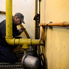 Plant Operator Keith Kendall tries to trigger a warning alarm on a pump during routine inspections, Monday, Dec. 3, 2012, at the City of Longmont Wastewater Treatment plant. Kendall has worked at the plant for 32 years.<br /> (Matthew Jonas/Times-Call)