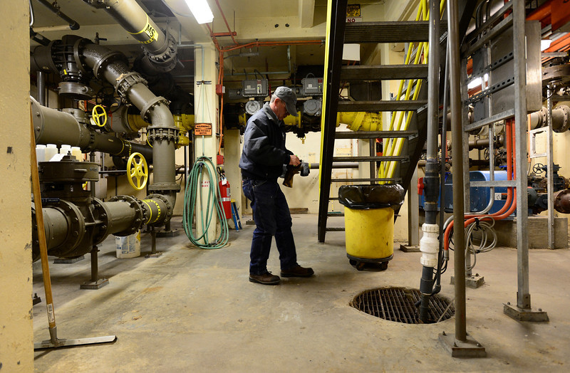 Plant Operator Keith Kendall checks off a list after testing a warning system on a pump, Monday, Dec. 3, 2012, at the City of Longmont Wastewater Treatment plant. Kendall has worked at the plant for 32 years.<br /> (Matthew Jonas/Times-Call)