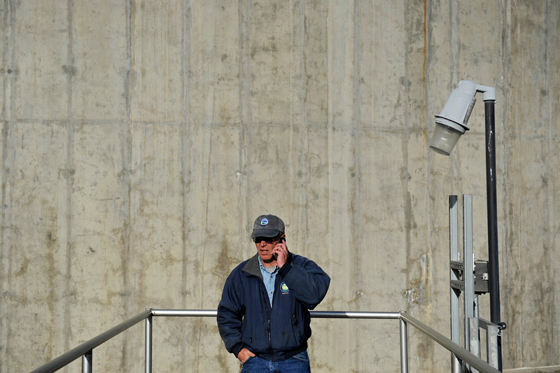 Plant Operator Keith Kendall calls in a work order after finding a corroded piece on an early warning system that needed to be replaced, Monday, Dec. 3, 2012, at the City of Longmont Wastewater Treatment plant. Kendall has worked at the plant for 32 years.<br /> (Matthew Jonas/Times-Call)