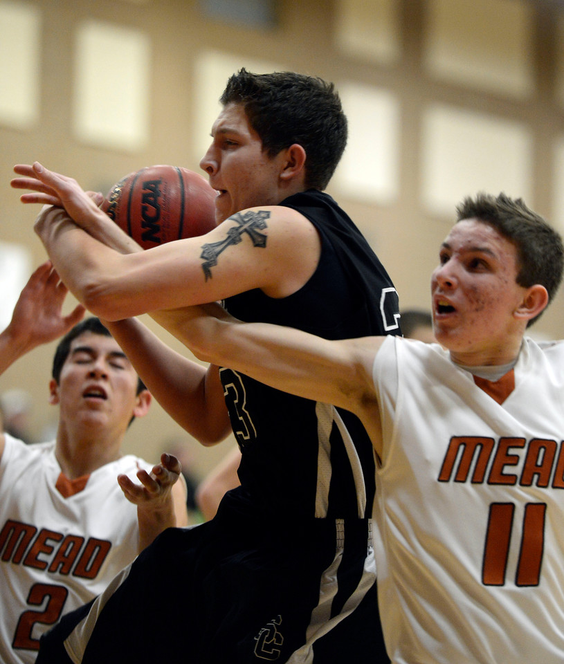 Mead's Conor Lamb and Silver Creek's Brock Johnson get tangled up underneath the basket in the second quarter Saturday night, Jan. 5, 2013 at Mead High School. (Lewis Geyer/Times-Call)