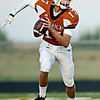 "Mead quarterback Griffin Nelson scrambles during the first half.  Mead faces St. Mary's during the varsity football game at Mead High School on Friday, Sept. 7, 2012.  For more photos visit  <a href=""http://www.TimesCall.com"">http://www.TimesCall.com</a>.<br /> (Greg Lindstrom/Times-Call)"
