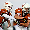 "Mead quarterback Griffin Nelson hands off to Logan Anderson (23) during the first half.  Mead faces St. Mary's during the varsity football game at Mead High School on Friday, Sept. 7, 2012.  For more photos visit  <a href=""http://www.TimesCall.com"">http://www.TimesCall.com</a>.<br /> (Greg Lindstrom/Times-Call)"
