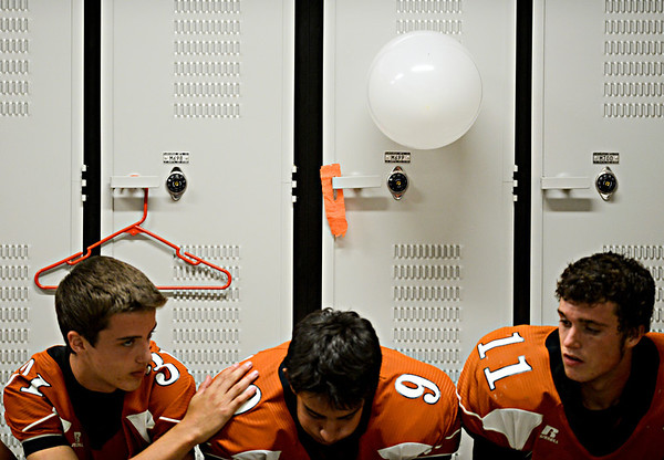 """Mead players, left to right, James Richardson, Leo Hammad and Tyler Tiano wait in the locker room before taking the field.  Mead lost to St. Mary's 21-20 during the varsity football game at Mead High School on Friday, Sept. 7, 2012.  For more photos visit  <a href=""""http://www.TimesCall.com"""">http://www.TimesCall.com</a>.<br /> (Greg Lindstrom/Times-Call)"""