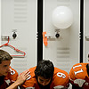 "Mead players, left to right, James Richardson, Leo Hammad and Tyler Tiano wait in the locker room before taking the field.  Mead lost to St. Mary's 21-20 during the varsity football game at Mead High School on Friday, Sept. 7, 2012.  For more photos visit  <a href=""http://www.TimesCall.com"">http://www.TimesCall.com</a>.<br /> (Greg Lindstrom/Times-Call)"