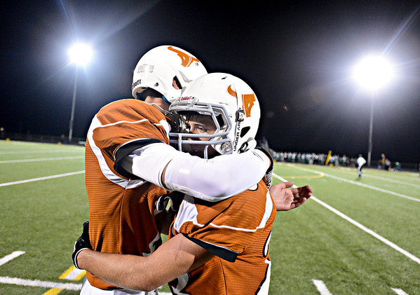 "Mead's Griffin Nelson, left, and Logan Anderson embrace after the Mavericks failed a 2-point conversion near the end of the fourth quarter.  Mead lost to St. Mary's 21-20 during the varsity football game at Mead High School on Friday, Sept. 7, 2012.  For more photos visit  <a href=""http://www.TimesCall.com"">http://www.TimesCall.com</a>.<br /> (Greg Lindstrom/Times-Call)"