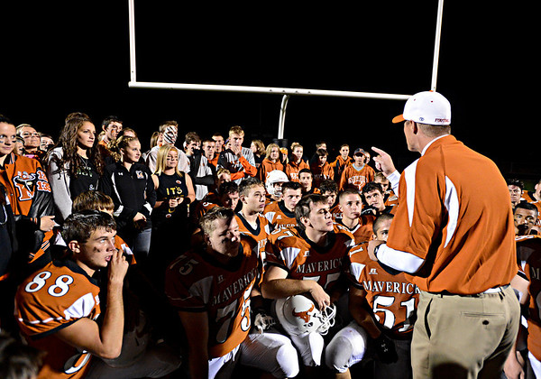 """Mead head coach Jason Klatt speaks to his team and Mead students on the field after the game.  Mead lost to St. Mary's 21-20 during the varsity football game at Mead High School on Friday, Sept. 7, 2012.  For more photos visit  <a href=""""http://www.TimesCall.com"""">http://www.TimesCall.com</a>.<br /> (Greg Lindstrom/Times-Call)"""